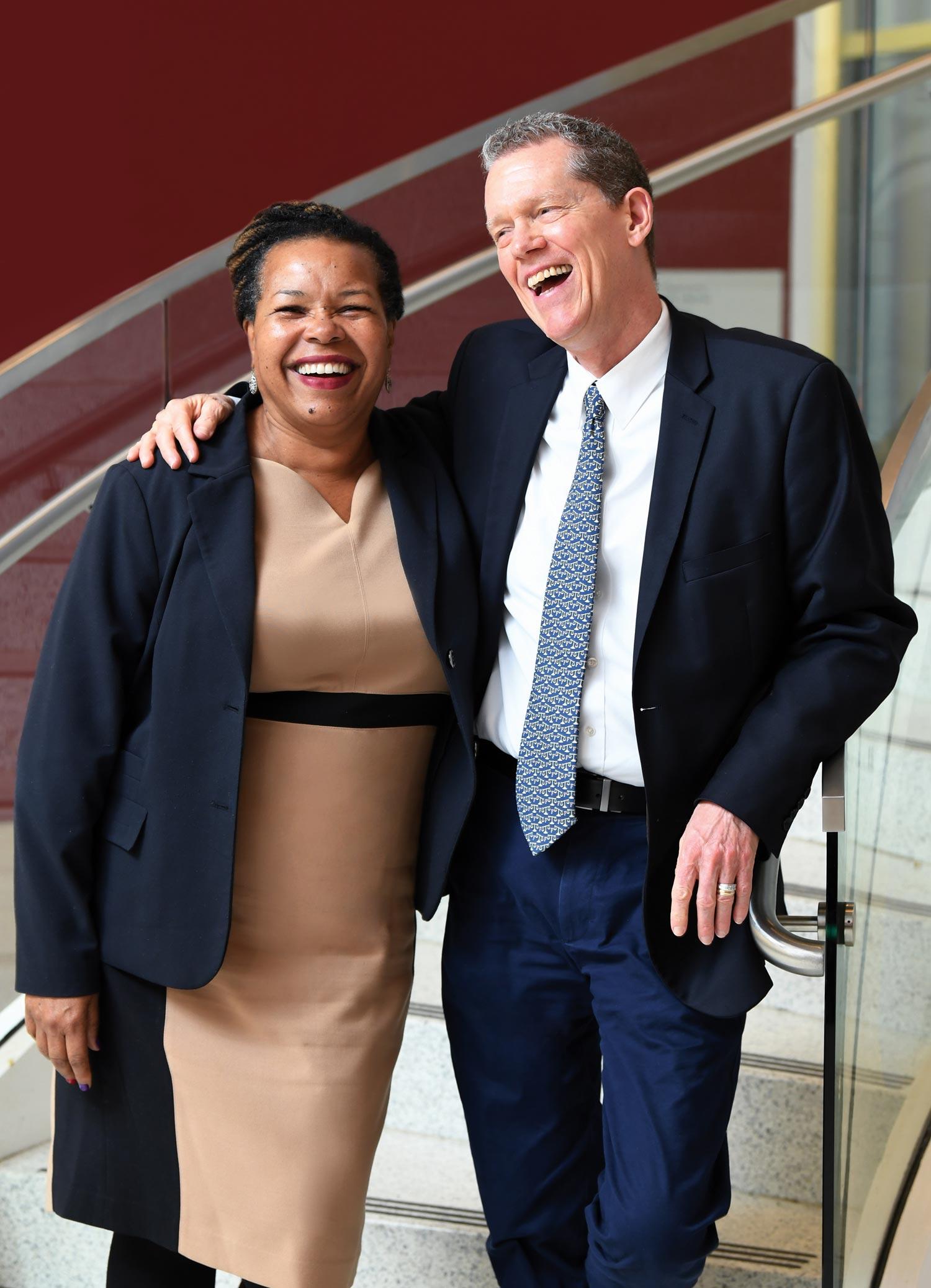 Nitza Escalera and Tom Schoenherr laughing together