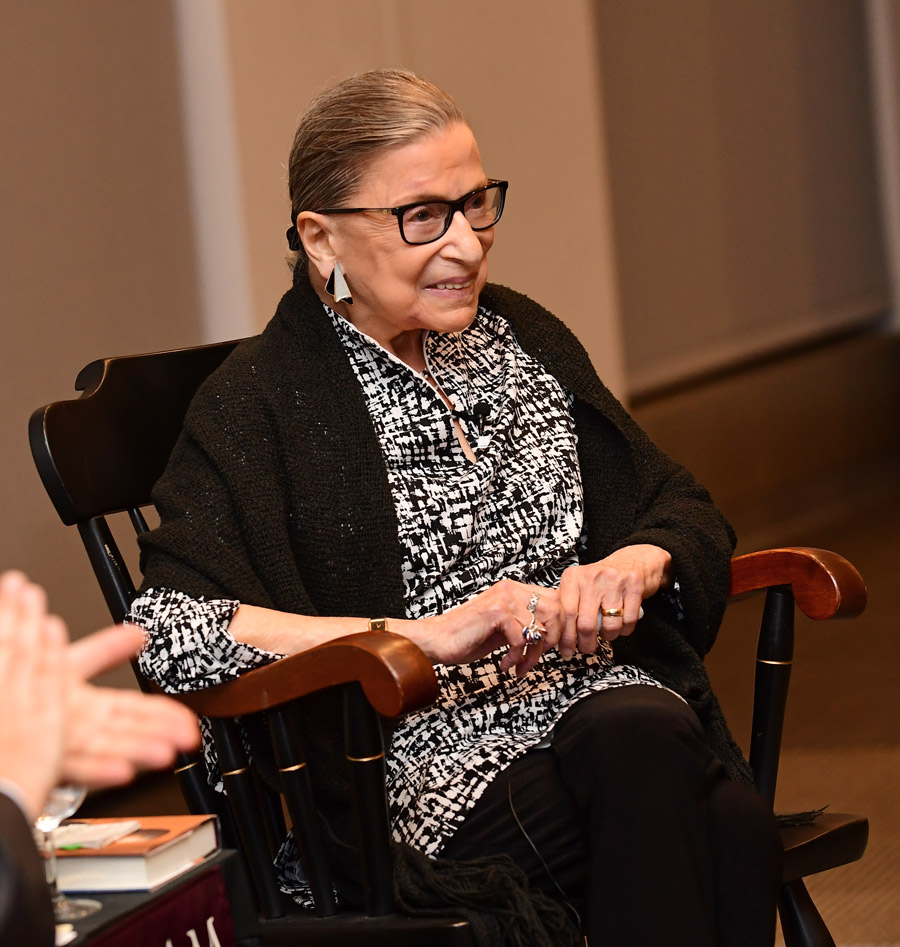 Ruth Bader Ginsburg sitting in a chair