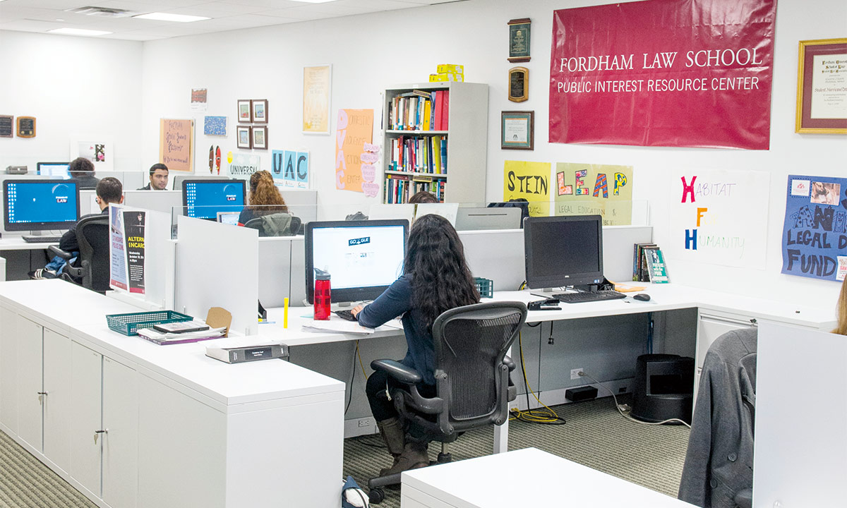 student inside the Fordham Law School Public Interest Resource Center